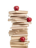 Stack of books with red apples Royalty Free Stock Images