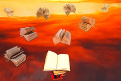 Stack of books and red sunset sky background Royalty Free Stock Photos