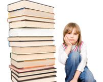 Stack of books and sad child Royalty Free Stock Images