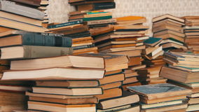 Stack of Books Scattered on the Floor in the Library stock video
