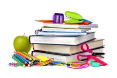 Stack of books and school supplies isolated on white Royalty Free Stock Photos