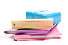 Stack of books with school supply on white Stock Image