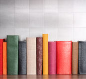 Stack of books on the shelf. Blank spines Royalty Free Stock Image
