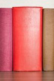 Stack of books on the shelf Royalty Free Stock Photos