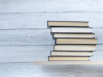 Stack of books on shelf. Education background. Back to school. Copy space for text. Stack of books on wooden shelf. Education background. Back to school. Copy Royalty Free Stock Photography