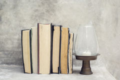 Stack of books on the shelf and near the lamp Royalty Free Stock Photos
