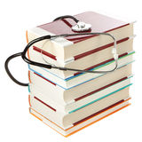 Stack of books and a stethoscope. Stock Images