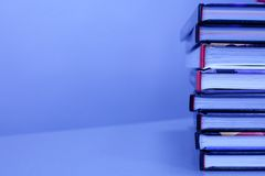 Stack of books on the table. In blue color. with copy-space stock photo