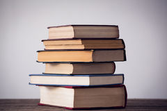 Stack of books on table Stock Image