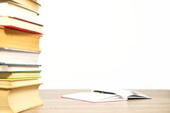 Stack of books on table isolated Royalty Free Stock Photography