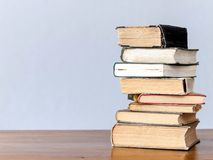 Stack of books on the table. A stack of old books on a wooden table Stock Image