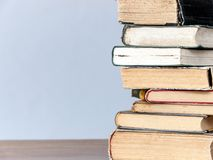 Stack of books on the table. A stack of old books on a wooden table royalty free stock images