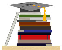 Stack of books with toga cap Royalty Free Stock Photos
