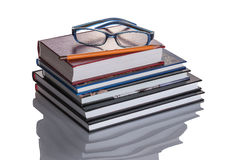 A stack of books. Top glasses and pencil Royalty Free Stock Photos