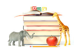 Stack of books with toy animals Royalty Free Stock Photo