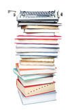 Stack of books and typewriter Royalty Free Stock Photos