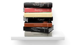 Stack of books with various subjects on wall shelf Stock Photos