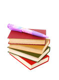 Stack of books and a very large ball-point pen Royalty Free Stock Photography