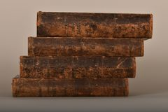 A stack of books in vintage frayed bindings royalty free stock photos