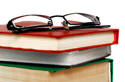 Stack of Books on white background. Clipping path. Stack of Books and Glasses on white background. Contains clipping path Stock Images