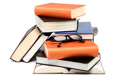 A stack of books on a white background. Royalty Free Stock Photos
