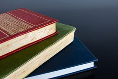 Stack Of Books in a Black Background royalty free stock images