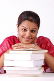 Stack of books with woman. Woman with neatly stack of books Stock Image