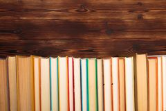 Stack of books on a wooden background.Education. Image stock photo