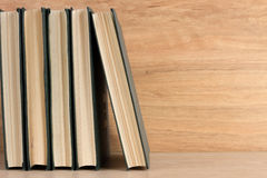 Stack of books on wooden background. Old vintage stack of books on wooden background stock photo