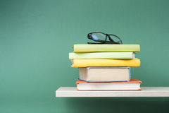 Stack of books on wooden shelf. Education background. Back to school. Copy space for text. Royalty Free Stock Photos