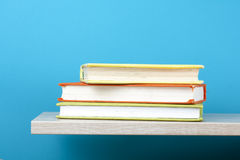 Stack of books on wooden shelf. Education background. Back to school. Copy space for text. Royalty Free Stock Images
