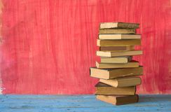 Stack of books. On a wooden shelf, free copy space Stock Photography