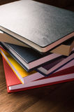 Stack of books on the wooden table Royalty Free Stock Images