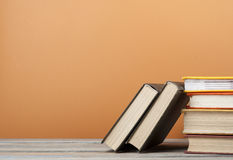 Stack of books on the wooden table. Education background.Back to school.Copy space for text. Royalty Free Stock Image