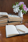 Stack of books on a wooden table with glasses Royalty Free Stock Images