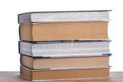 Stack of books on a wooden table stock photography