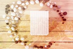 Stack of books on a wooden table, toned. Top view of a stack of books with blank covers lying on a wooden table inside a crescent made of pebbles. 3d rendering Stock Photo