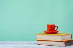Stack of books on wooden tablle with a cup  tea. Education background. Back to school. Copy space for text. Stock Photography