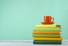 Stack of books on wooden tablle with a cup  tea. Education background. Back to school. Copy space for text. Stock Photo