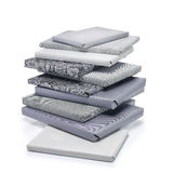 Stack of books. Wrapped gift in grey color. Clipping path Stock Photos