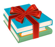 Stack of books wrapped with a red ribbon Royalty Free Stock Photography