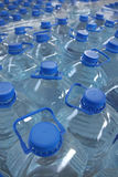 Stack bottled water. Detail of stack bottled water in industry royalty free stock photos