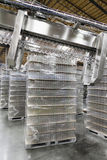 Stack of bottled water kept in warehouse Stock Photo