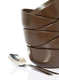 Stack of bowls and spoons Stock Photos