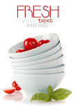 Stack of bowls and tomatoes Royalty Free Stock Images