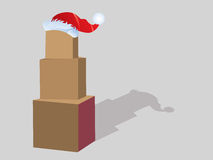 Stack of boxes with santa hat Royalty Free Stock Photography