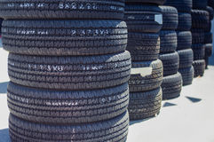 Stack of Brand New Automobile Black Tyres Stock Image