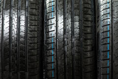 Stack of brand new high performance car tires Royalty Free Stock Images