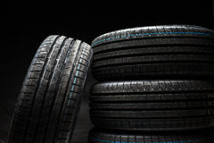 Stack of brand new high performance car tires Stock Photos