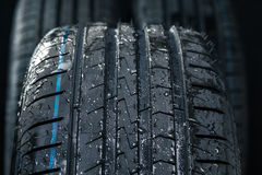 Stack of brand new high performance car tires Royalty Free Stock Photo